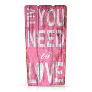 Drewniana tablica różowa z napisami