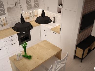 Bardzo funkcjonalna aranżacja małej kuchni z wyspą, która pełni jednocześnie funkcję stołu śniadaniowego. Industrialne lampy wiszące o czarnych kloszach dobrze współgrają ze skandynawskim klimatem, jaki dominuje we wnętrzu. Białe szafki i drewno tworzą przyjemny naturalny charakter całego...