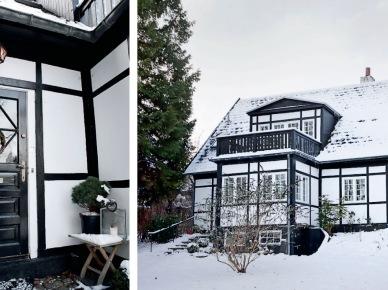 Czarne drzwi i belki w elewacji białego domku (19691)