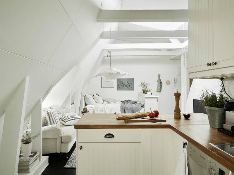 Mała biała kuchnia skandynawska w otwartym  zdjęcie w serwisie Lovingit pl (