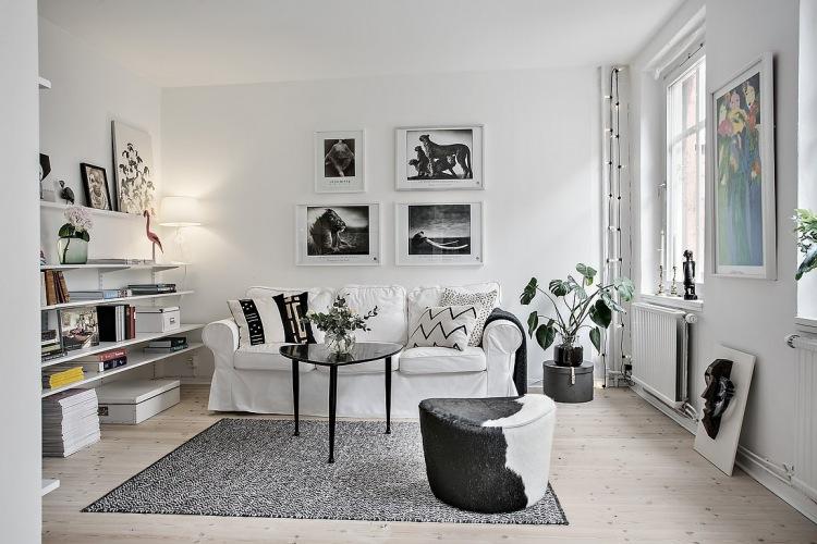 Aranżacja białego mieszkania z grafitowymi dodatkami i sprytną garderobą w sypialni!