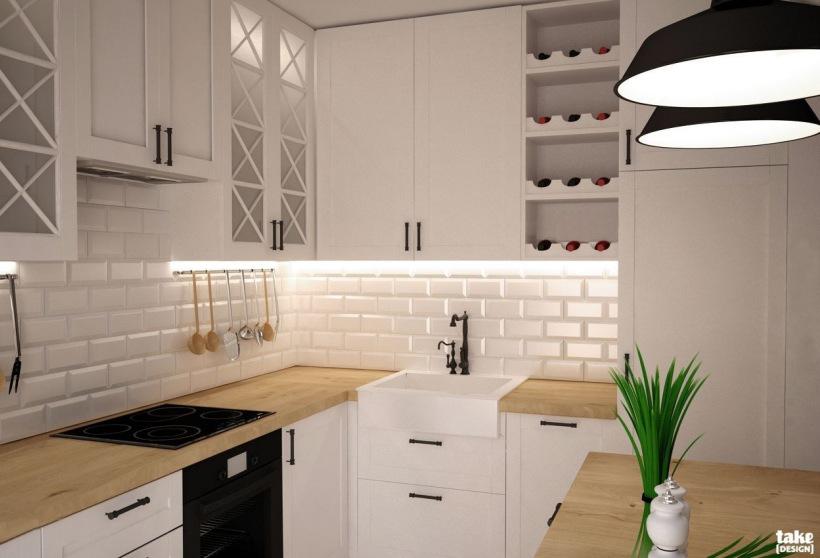 Aranżacja kuchni z białymi szafkami z miejscem  zdjęcie w   -> Male Kuchnie W Bloku Aranzacje